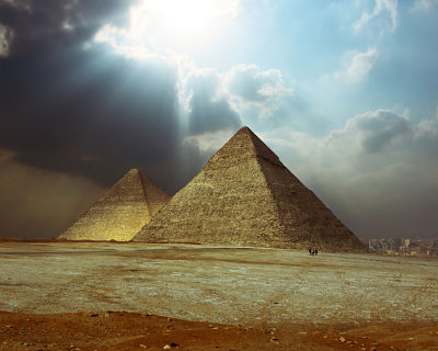 Sunlight over grate Giza pyramids.